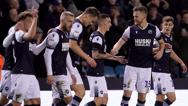 Shaun Williams (centre) is congratulated on his goal for Millwall