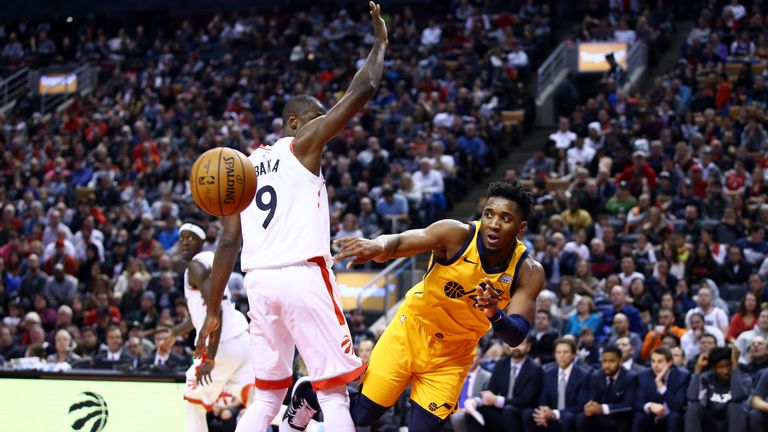 Donovan Mitchell of the Utah Jazz passes the ball as Serge Ibaka of the Toronto Raptors defends during the second half