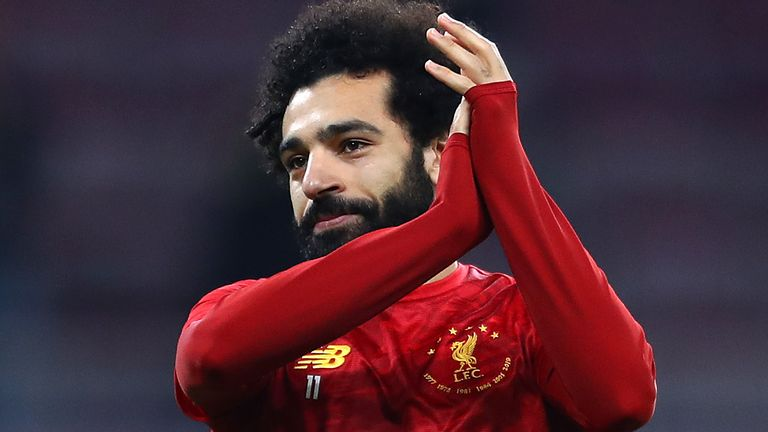 Mo Salah warms up ahead of Liverpool's Club World Cup semi-final