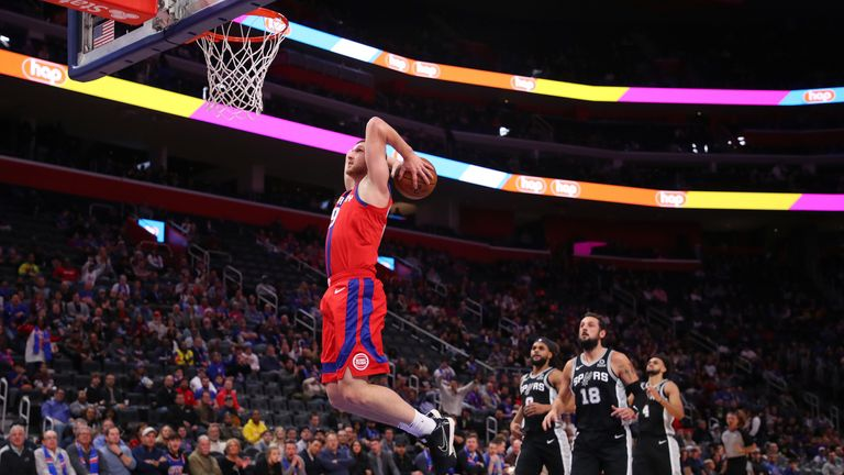 Sviatoslav Mykhailiuk of the Detroit Pistons gets in front of the San Antonio Spurs defence for a first half dunk
