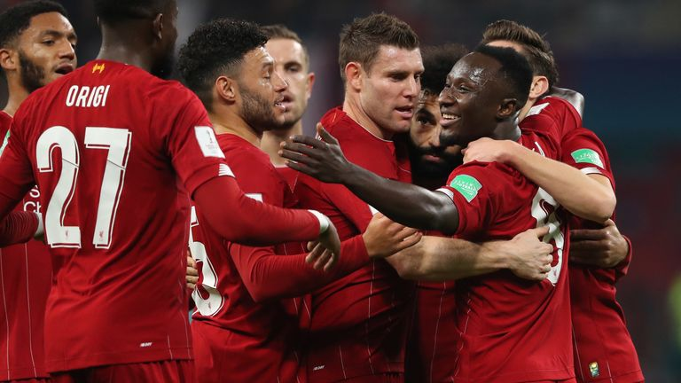 DOHA, QATAR - DECEMBER 18: Naby Keita of Liverpool celebrates with his team mates after scoring a goal to make it 0-1 during the FIFA Club World Cup Qatar 2019 Semi Final match between Monterrey and Liverpool FC at Khalifa International Stadium on December 18, 2019 in Doha, Qatar. (Photo by Matthew Ashton - AMA/Getty Images)
