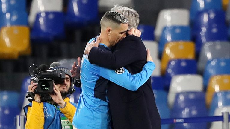 Ancelotti embraces Jose Callejon at the final whistle against Genk