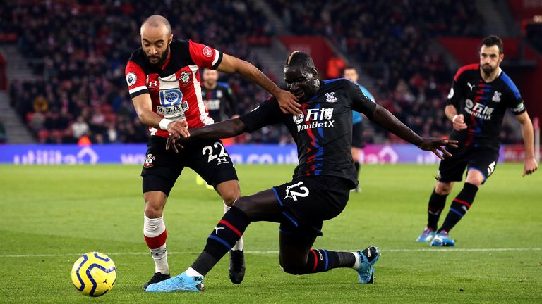 Nathan Redmond is tackled by Mamadou Sakho