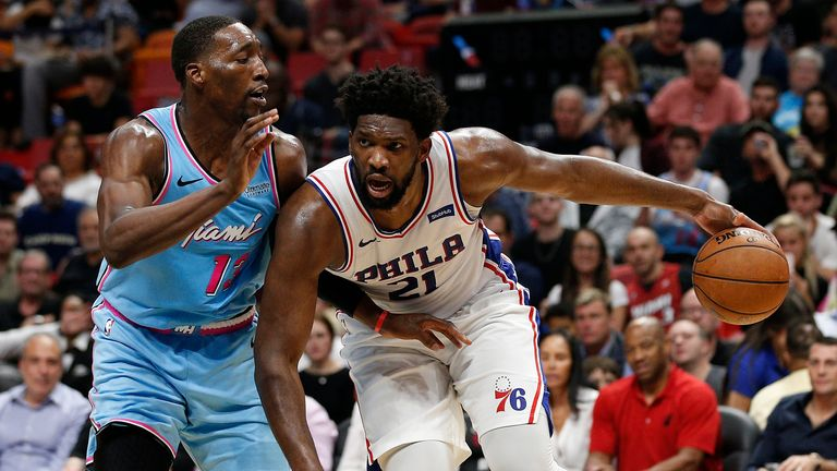 MIAMI, FLORIDA - DECEMBER 28: Joel Embiid #21 of the Philadelphia 76ers drives to the basket against Bam Adebayo #13 of the Miami Heat during the second half at American Airlines Arena on December 28, 2019 in Miami, Florida. NOTE TO USER: User expressly acknowledges and agrees that, by downloading and/or using this photograph, user is consenting to the terms and conditions of the Getty Images License Agreement. (Photo by Michael Reaves/Getty Images)