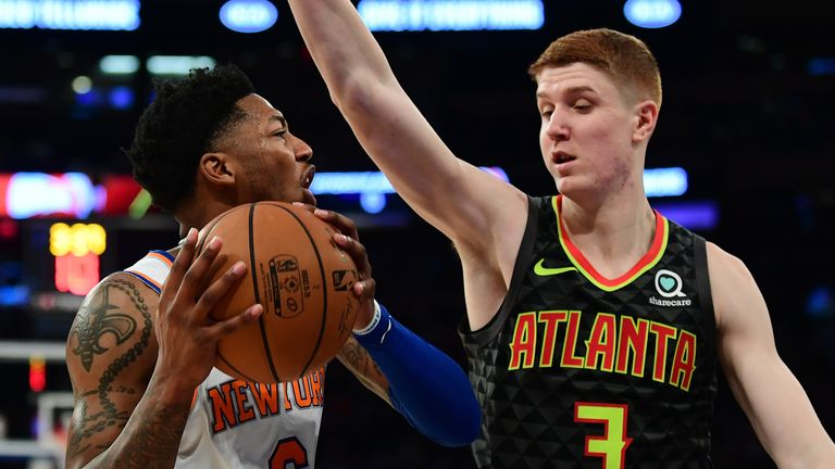 Elfrid Payton of the New York Knicks is guarded by Kevin Huerter of the Atlanta Hawks
