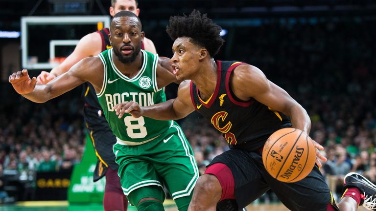 Collin Sexton of the Cleveland Cavaliers drives past Kemba Walker of the Boston Celtics in the first half at TD Garden