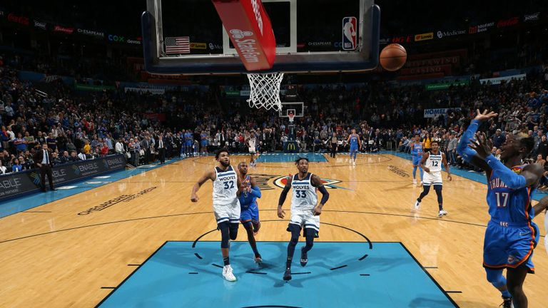Dennis Schroder #17 of the Oklahoma City Thunder makes the shot to send the game into overtime against the Minnesota Timberwolves