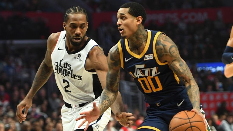 LOS ANGELES, CA - DECEMBER 28: Kawhi Leonard #2 of the Los Angeles Clippers guards Jordan Clarkson #00 of the Utah Jazz as he drives to the basket in the second half of the game at Staples Center on December 28, 2019 in Los Angeles, California. NOTE TO USER: User expressly acknowledges and agrees that, by downloading and/or using this Photograph, user is consenting to the terms and conditions of the Getty Images License Agreement. (Photo by Jayne Kamin-Oncea/Getty Images)