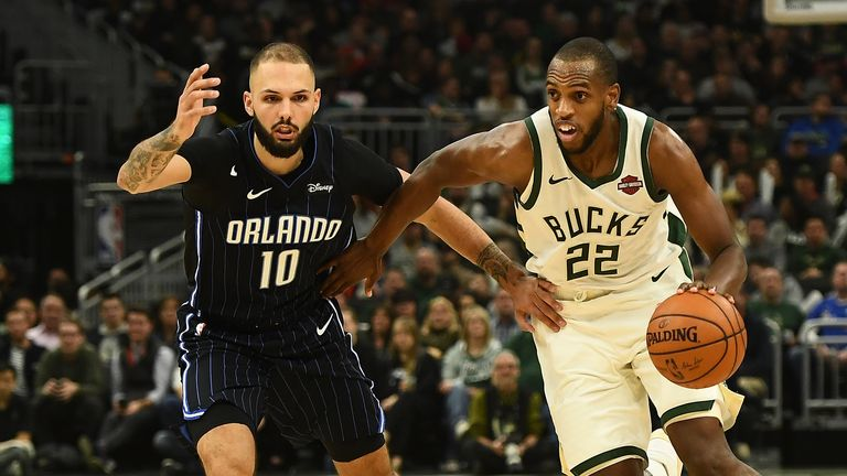 MILWAUKEE, WISCONSIN - DECEMBER 28: Khris Middleton #22 of the Milwaukee Bucks is defended by Evan Fournier #10 of the Orlando Magic during the first half of a game at Fiserv Forum on December 28, 2019 in Milwaukee, Wisconsin. NOTE TO USER: User expressly acknowledges and agrees that, by downloading and or using this photograph, User is consenting to the terms and conditions of the Getty Images License Agreement. (Photo by Stacy Revere/Getty Images)