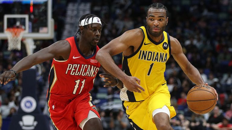 NEW ORLEANS, LOUISIANA - DECEMBER 28: T.J. Warren #1 of the Indiana Pacers drives the ball around Jrue Holiday #11 of the New Orleans Pelicans at Smoothie King Center on December 28, 2019 in New Orleans, Louisiana. NOTE TO USER: User expressly acknowledges and agrees that, by downloading and/or using this photograph, user is consenting to the terms and conditions of the Getty Images License Agreement (Photo by Chris Graythen/Getty Images)