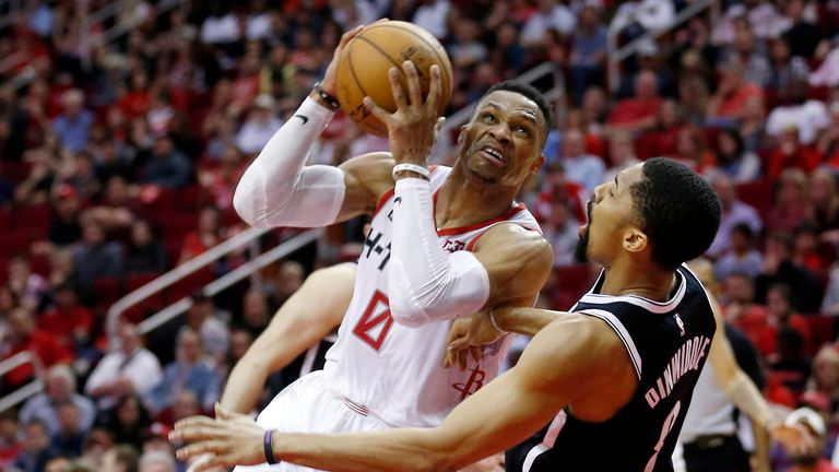 HOUSTON, TEXAS - DECEMBER 28: Russell Westbrook #0 of the Houston Rockets is called for an offensive foul as he knocks over Spencer Dinwiddie #8 of the Brooklyn Nets at Toyota Center on December 28, 2019 in Houston, Texas. NOTE TO USER: User expressly acknowledges and agrees that, by downloading and/or using this photograph, user is consenting to the terms and conditions of the Getty Images License Agreement. (Photo by Bob Levey/Getty Images)
