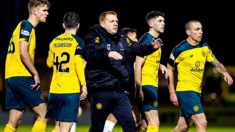 Neil Lennon celebrated with the away fans after Celtic kept up their winning run, which stretches back to October 6