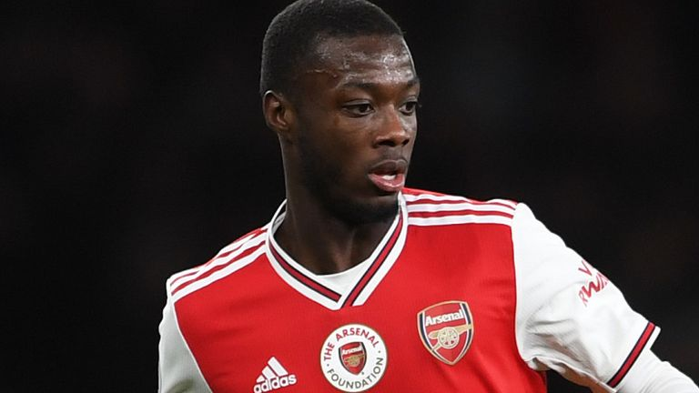 Nicolas Pepe has possession of the ball during Arsenal's match against Manchester City in December