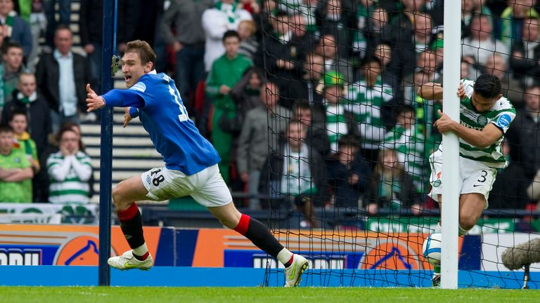 Nikica Jelavic (left) wheels away to celebrate in 2011 as his shot finally creeps over the line despite the efforts of Celtic's Emilio Izaguirre