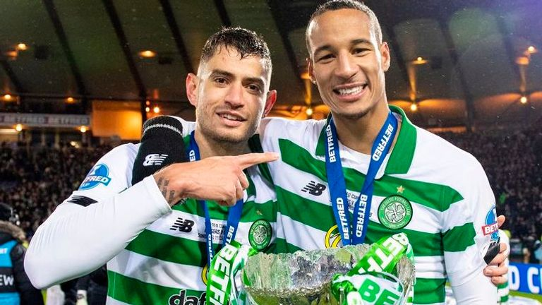 Bitton (left) celebrates winning the Scottish League Cup title with Christopher Jullien