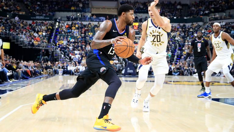 Paul George of the Los Angeles Clippers dribbles the ball against the Indiana Pacers