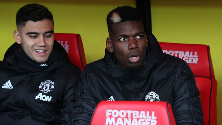 WATFORD, ENGLAND - DECEMBER 22: Paul Pogba of Manchester United watches from the bench ahead of the Premier League match between Watford FC and Manchester United at Vicarage Road on December 22, 2019 in Watford, United Kingdom. (Photo by Matthew Peters/Manchester United via Getty Images)