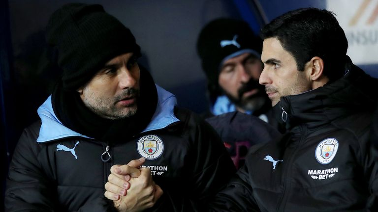 Pep Guardiola manager of Manchester City with Mikel Arteta assistant coach of Manchester City during the Carabao Cup Quarter Final match between Oxford United and Manchester City at Kassam Stadium on December 18, 2019 in Oxford, England.