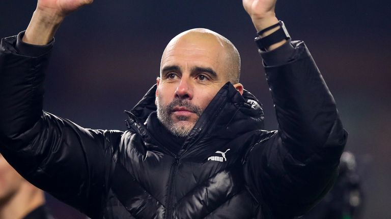 Pep Guardiola celebrates Manchester City's 4-1 win at Burnley on Tuesday