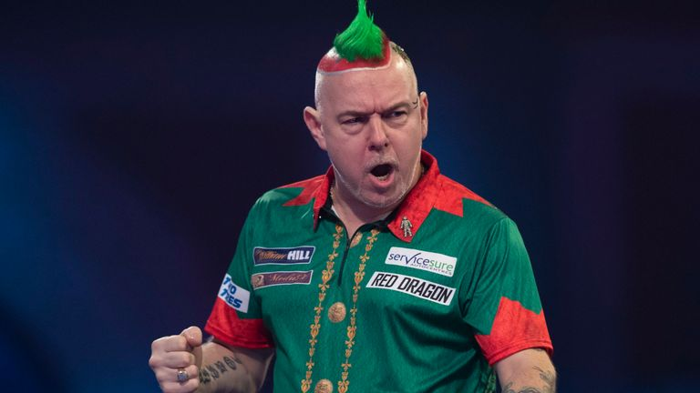 Peter Wright, complete in his Elf outfit, defeated Noel Malicdem in a sudden-death leg thriller on Friday night at Alexandra Palace