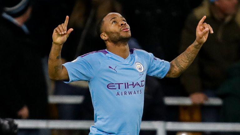 Raheem Sterling celebrates scoring Manchester City's second goal against Wolves