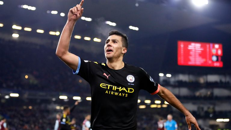 """Manchester City's Rodrigo celebrates scoring his sides third goal during the Premier League match at Turf Moor, Burnley. PA Photo. Picture date: Tuesday December 3, 2019. See PA story SOCCER Burnley. Photo credit should read: Martin Rickett/PA Wire. RESTRICTIONS: EDITORIAL USE ONLY No use with unauthorised audio, video, data, fixture lists, club/league logos or """"live"""" services. Online in-match use limited to 120 images, no video emulation. No use in betting, games or single club/league/player publications."""