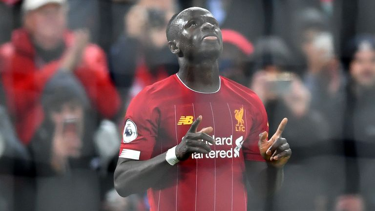 Sadio Mane celebrates making it 4-1 against Everton