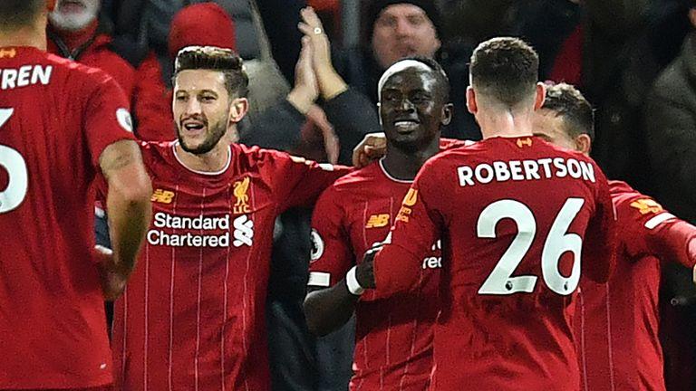 Sadio Mane celebrates with team-mats after scoring Liverpool's fourth goal