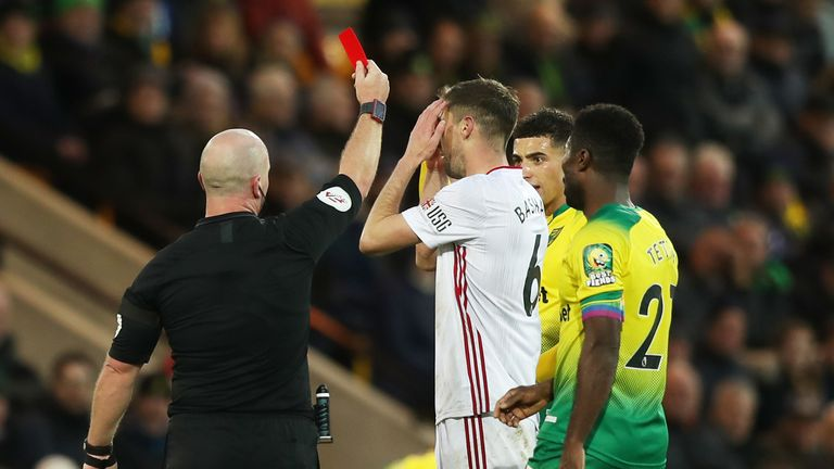 Chris Basham was initially shown a straight red card by referee Simon Hooper - before VAR intervened