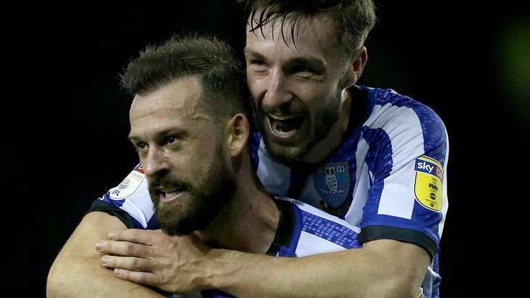 Steven Fletcher celebrates with Morgan Fox after the Sky Bet Championship match between Sheffield Wednesday and Brentford