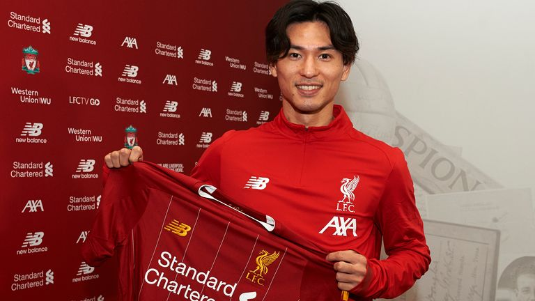 Takumi Minamino pictured with a Liverpool shirt after signing from Red Bull Salzburg