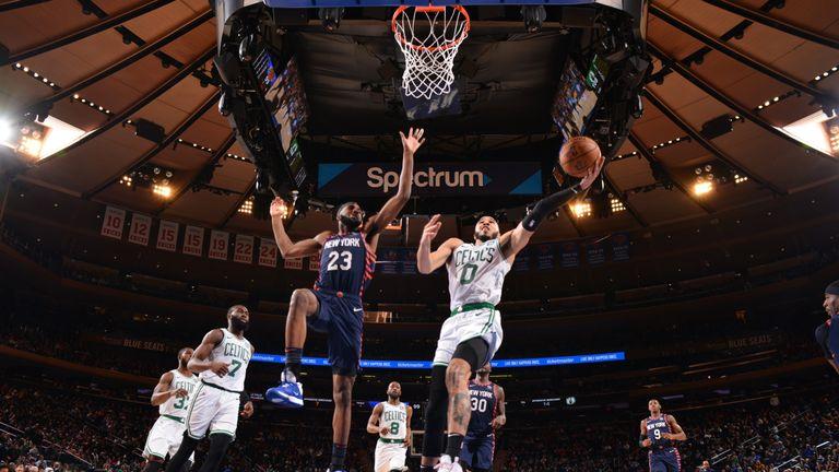 Jayson Tatum of the Boston Celtics shoots the ball against the New York Knicks