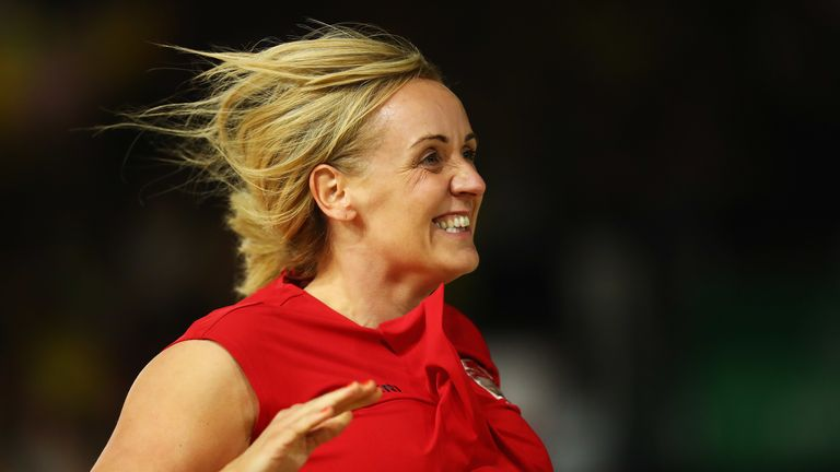 Tracey Neville joining her players on court after winning the final of the 2018 Commonwealth Games