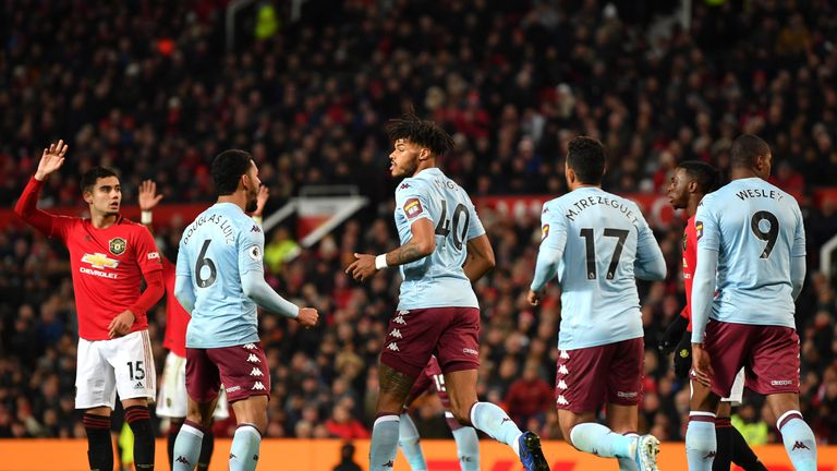 Tyrone Mings wheels away after equalising for Aston Villa at Manchester United