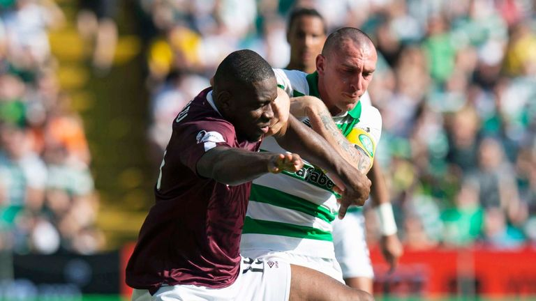 Hearts' Uche Ikpeazu (L) in action with Celtic's Scott Brown.