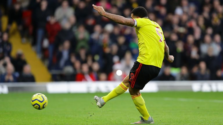 Watford captain Troy Deeney strokes home the penalty to make it 2-0