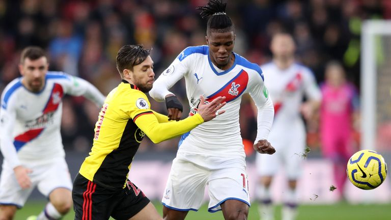 Wilfried Zaha and Kiko Femenia compete for possession