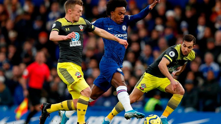 Willian is put under pressure by James Ward-Prowse and  Cedric Soares