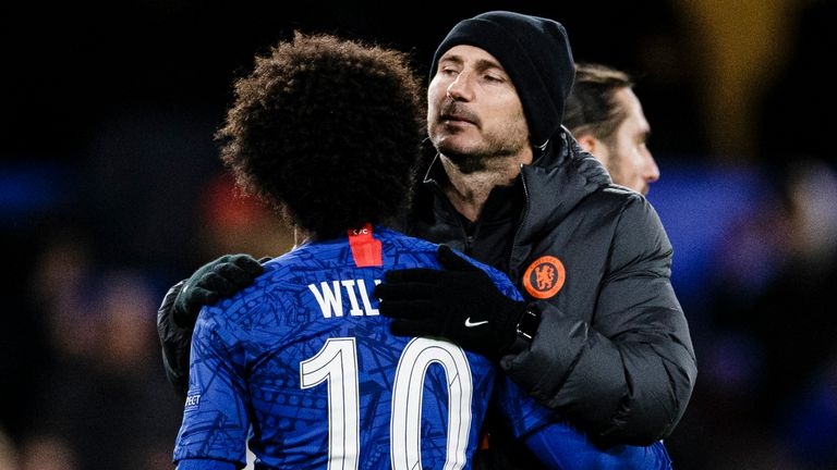 Chelsea FC Head Coach Frank Lampard (R) hugs Willian da Silva of Chelsea (L) after winning Lile during the UEFA Champions League group H match between Chelsea FC and Lille OSC at Stamford Bridge on December 10, 2019 in London, United Kingdom.