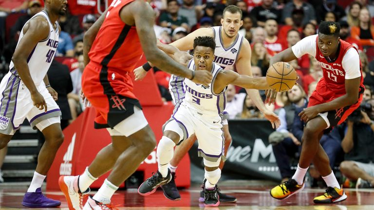 Yogi Ferrell of the Sacramento Kings dribbles on a fast break in the second half against the Houston Rockets