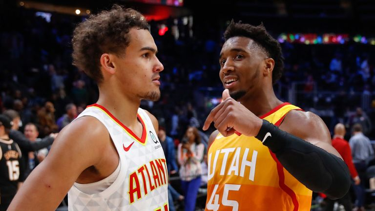 Donovan Mitchell shares a word with Trae Young