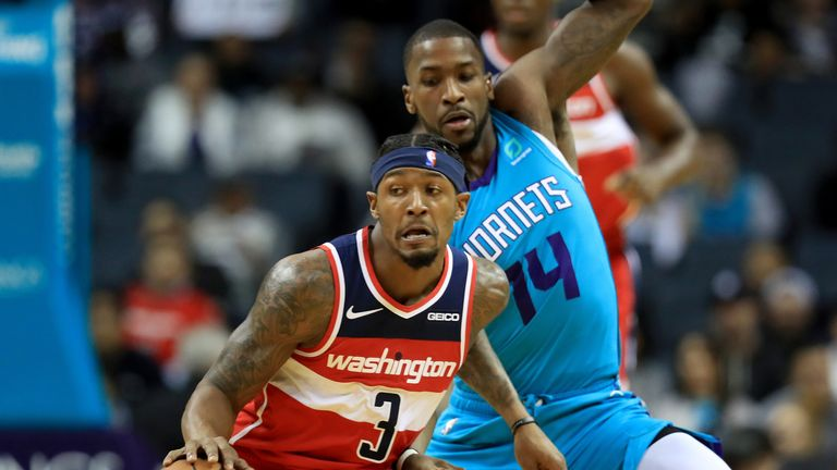 Bradley Beal protects the ball from the Hornets defense