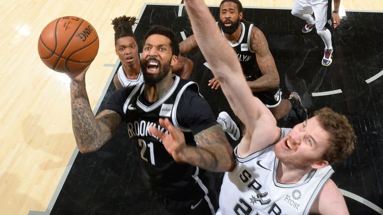 Wilson Chandler attacks the basket against the San Antonio Spurs