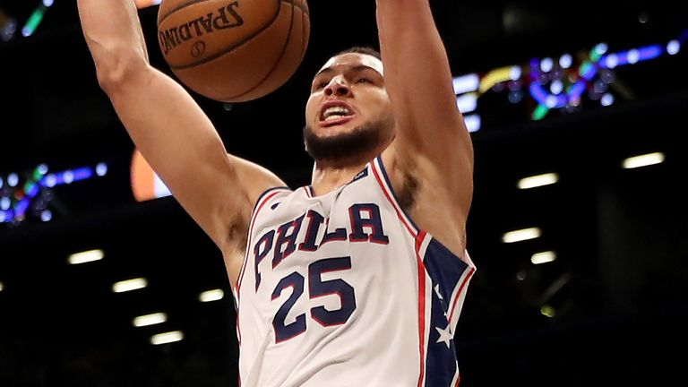 Ben Simmons scores with a dunk en route to a triple-double against Brooklyn