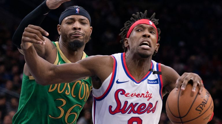 Marcus Smart challenges Josh Richardson as the Sixers forward drives to the basket