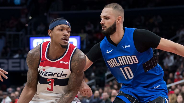 Bradley Beal is guarded by Evan Fournier