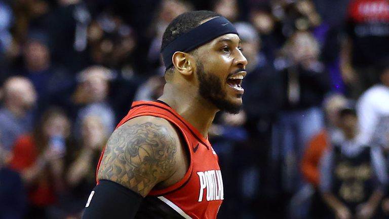 Carmelo Anthony reacts after sinking a game-winning shot against the Toronto Raptors