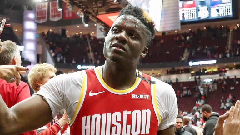 Clint Capela high-fives fans after a Rockets win