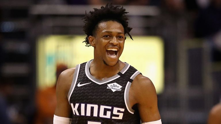 De'Aaron Fox celebrates a basket during the Kings' victory over the Suns