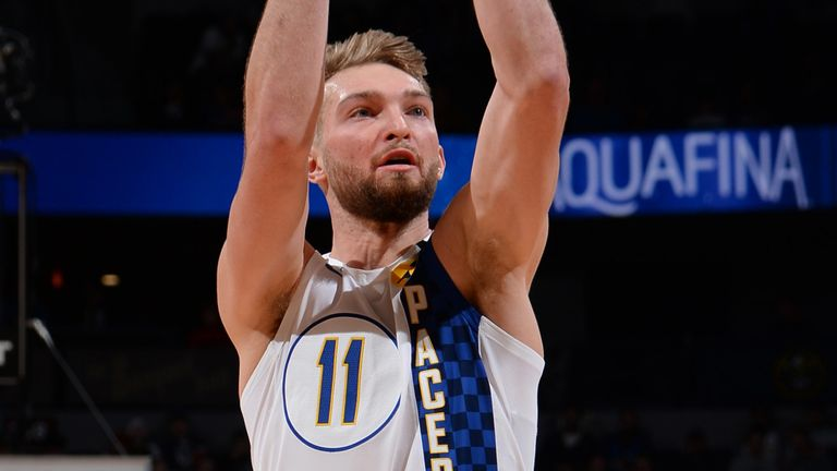 Domantas Sabonis fires from three en route to a triple-double against the Nuggets